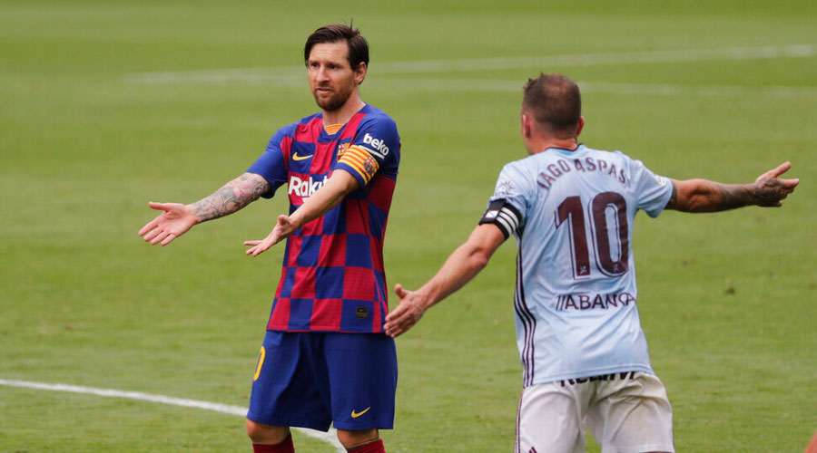 Barcelona's Lionel Messi gestures during a Spanish La Liga soccer match between RC Celta and Barcelona