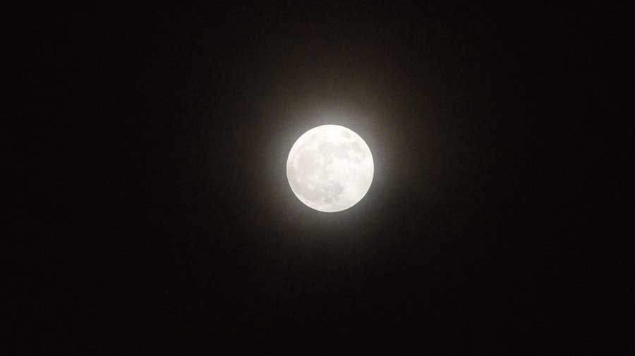 "Blue moon: The second full moon of this month,  that some sky watchers called the ""blue moon"",  seen from the EM Bypass around 7pm on Saturday.  The moon is not going to look blue, Debiprosad Duari, the director (research and academic) of MP Birla Planetarium, had said.  ""In modern parlance, a blue moon is the second full  moon in a calendar month. The time between one full moon and the next is close  to the length of a calendar month. So, the only time  one month can have two  full moons is when the first full moon happens in the first few days of the  month, in this case  on October 1."" But the original concept  of a blue moon is part of folklore and practices of  the medieval agrarian society, Duari said."
