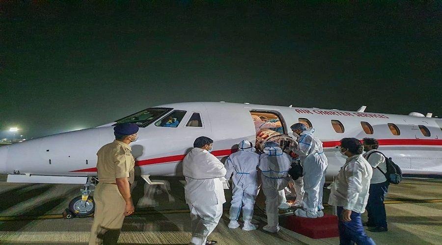 Jagarnath Mahto being put on an air ambulance at Ranchi airport to be taken to Chennai on October 19.