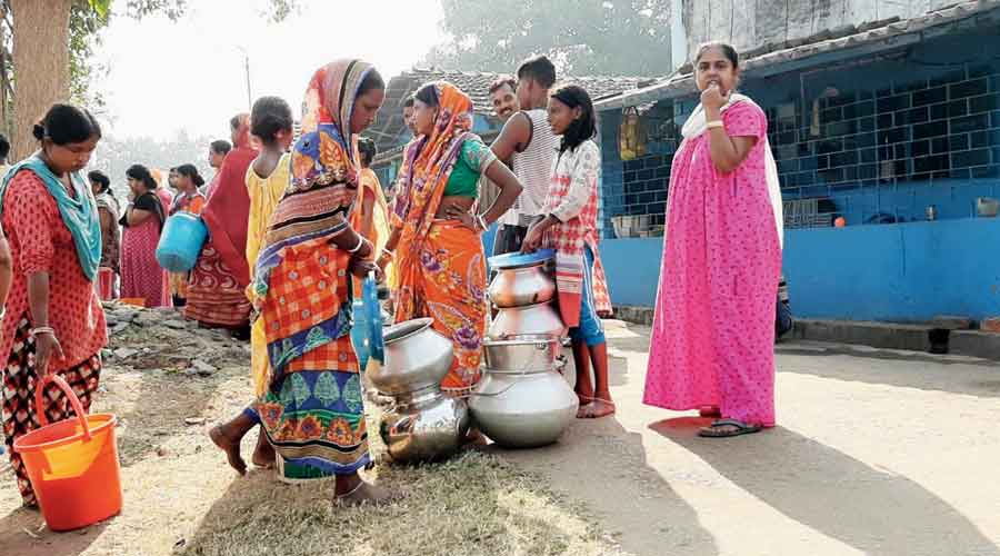 People line up for water supplied by Durgapur Municipal Corporation  in tanks in the town on Monday