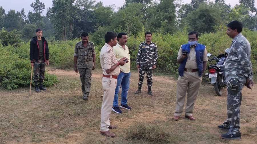 Police officers investigate the rape case in a forest in Chatra on Tuesday.
