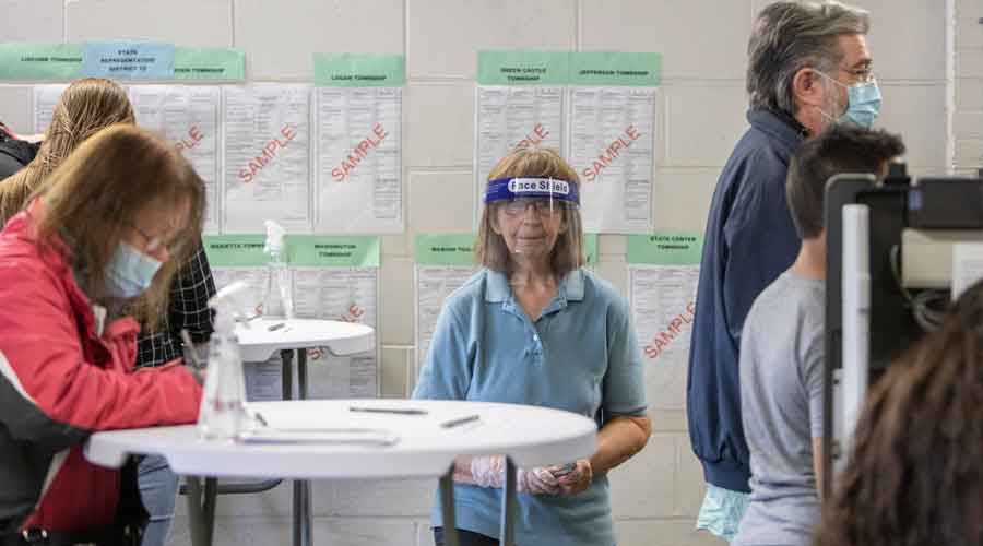 An election worker at a polling place in Iowa