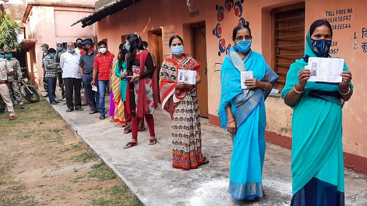 Voters wait in queue to cast their vote at a polling booth in Dumka on Tuesday.