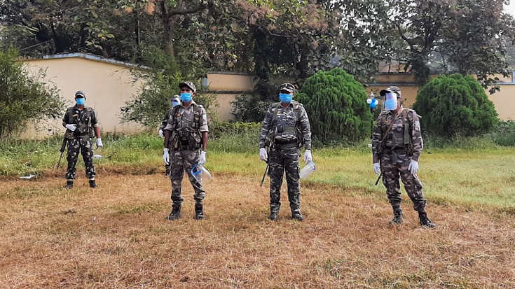 CRPF personnel on standby at a polling booth in Bermo on Tuesday.