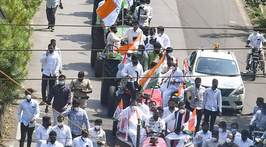 Congress party workers stage a tractor rally against new farm laws, in Kolhapur, Thursday, November 5, 2020.