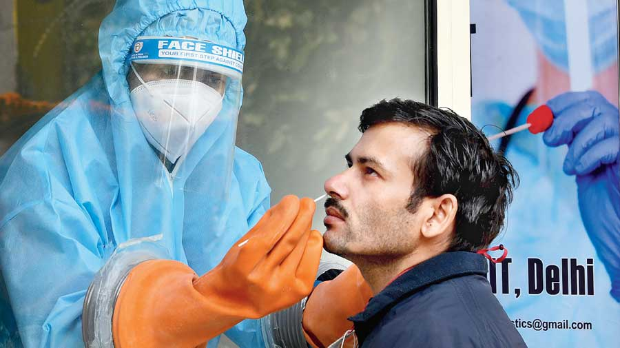A health worker collects swab samples for the Covid-19 test at IIT Delhi on Friday.