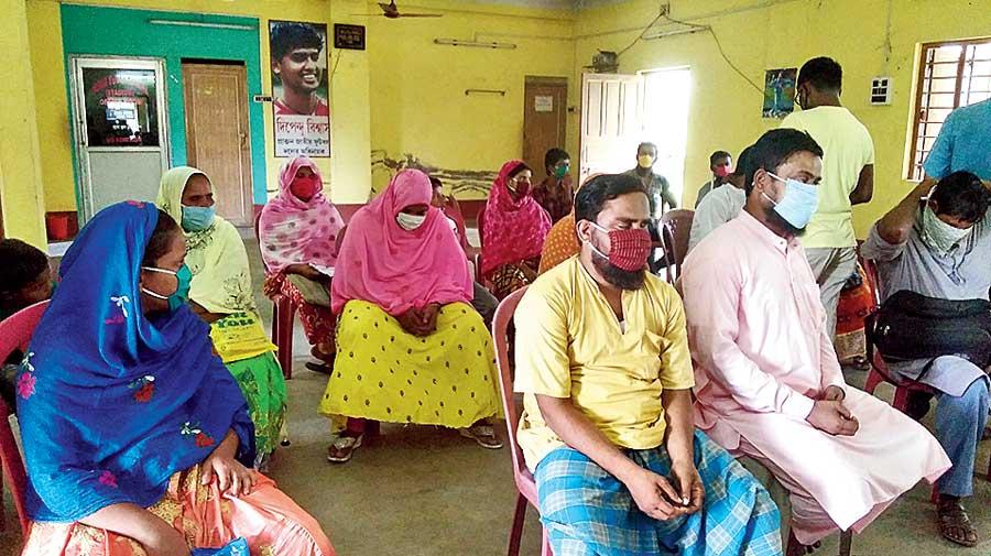 A gathering at Beldanga, Murshidabad, to collect relief kits.