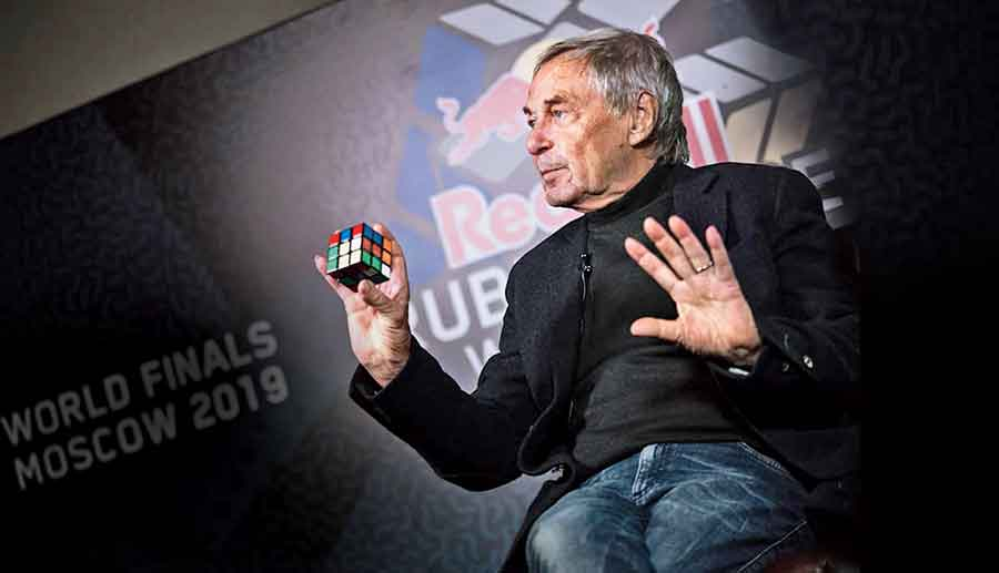 Erno Rubik with his invention during the Red Bull Rubik's Cube World Cup finals in Moscow (2019).