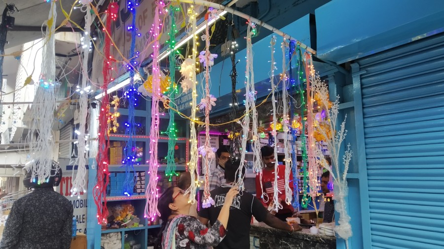 A customer checking out made in China lights at Bistupur Market, on Monday.