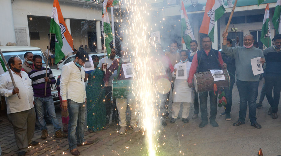 Congress workers burst crackers at the party office in Ranchi on Tuesday.