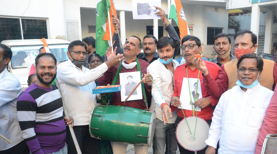 Congress workers celebrate after the victory of their candidate in Bermo at the party office in Ranchi on Tuesday.