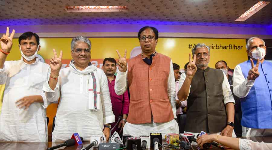 Bihar Deputy CM Sushil Kumar Modi, BJP Bihar in-charge Bhupendra Yadav, BJP Bihar President Sanjay Jaiswal and MoS Nityanand Rai flash victory sign during a press conference following NDAs lead during the counting of votes for the Bihar Assembly Elections results, in Patna, Tuesday