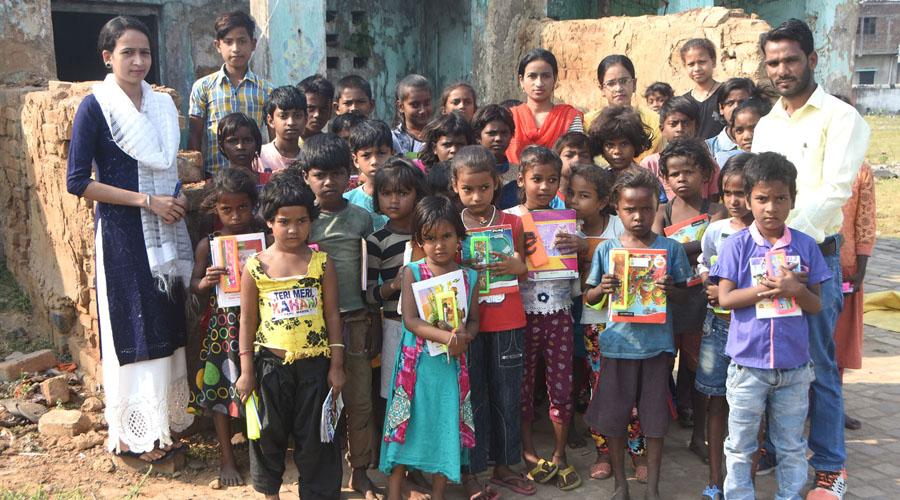 Irfan Alam, Founder cum Secretary, Saathi Foundation, teachers along with the children at the school in Wasseypur, Dhanbad on Sunday.