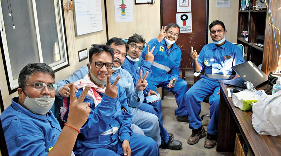 Members of the Oil India team show the victory sign after killing the Baghjan well on Sunday.