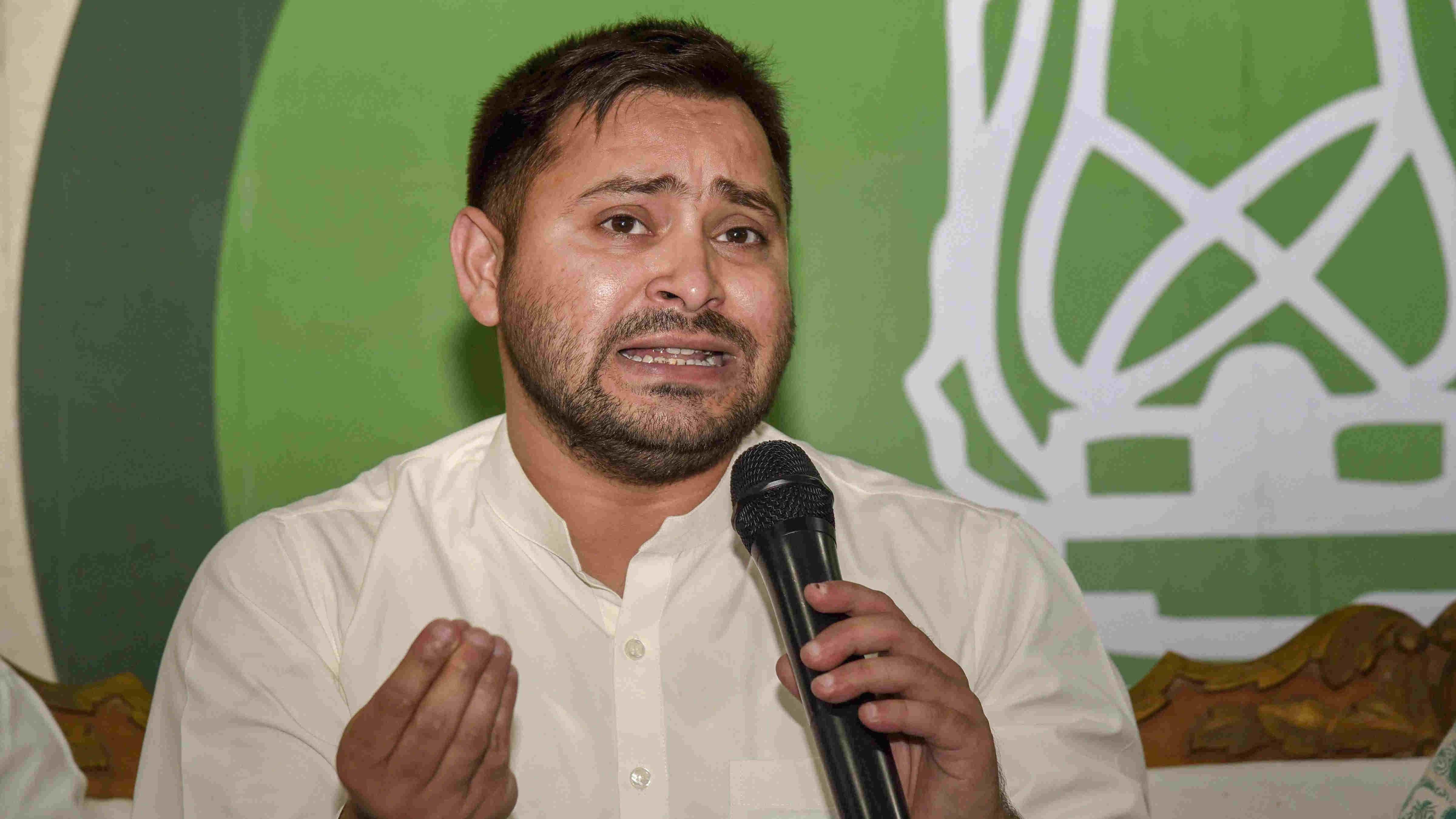 RJD leader Tejashwi Yadav addresses a press conference, in Patna, Thursday, Nov. 12, 2020.