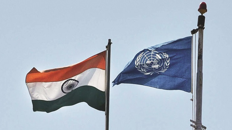 The flags of India and the United Nations fly together.