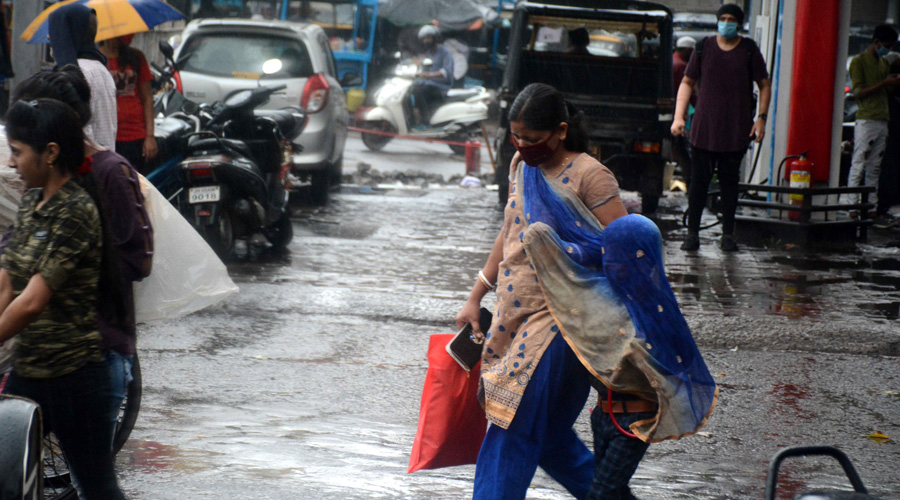 Commuters caught in sudden showers at Sakchi in Jamshedpur on Thursday evening.