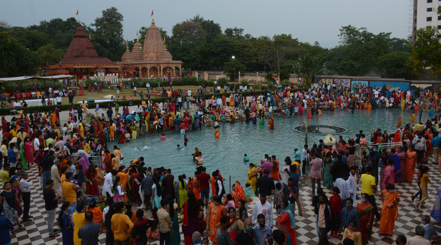 Devotees celebrate Chhath at the Surya Mandir on Friday evening.