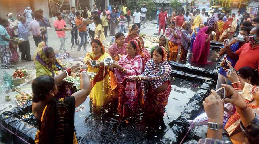 Chhath rituals being performed at a temporary water body opposite Subhas Sarobar on Friday