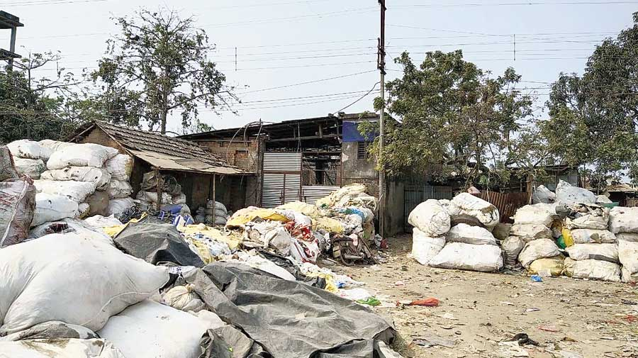 Heaps of scrap plastic lie outside a crushing unit at Sujapur.