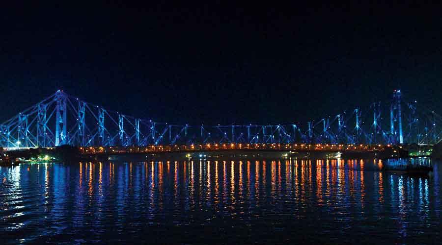 The Howrah bridge illuminated with blue lights on Friday