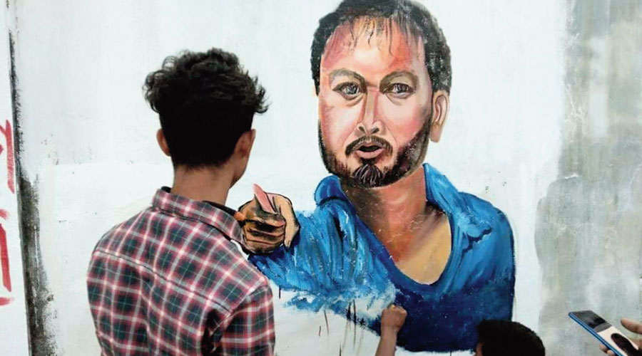Some of the graffiti and slogans on Akhil Gogoi that came up at two places at Amguri in (below) Sivasagar district of Assam on Friday