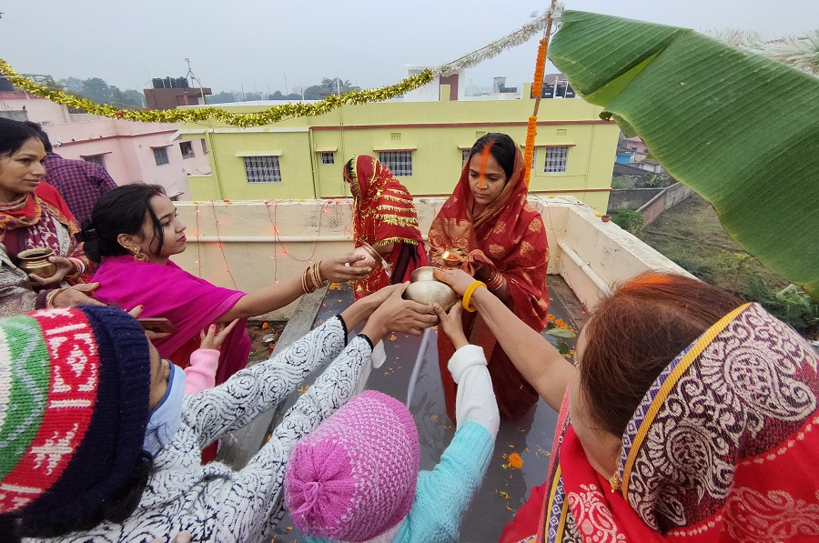 Devotees offer prayers in their respective homes by making permanent water tubs, in Ranchi on Saturday.
