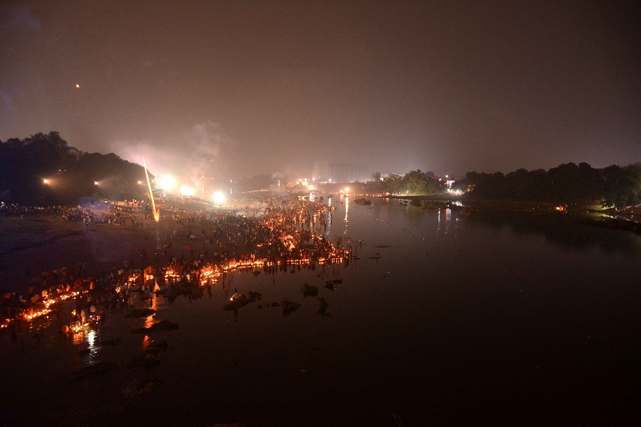 Diyas lit by devotees float at the Subernarekha ghat in Sakchi on Saturday morning.