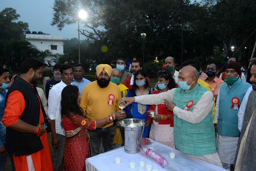 Local legislator Sarayu Roy distributes milk on the premises of Surya Mandir on Saturday morning.