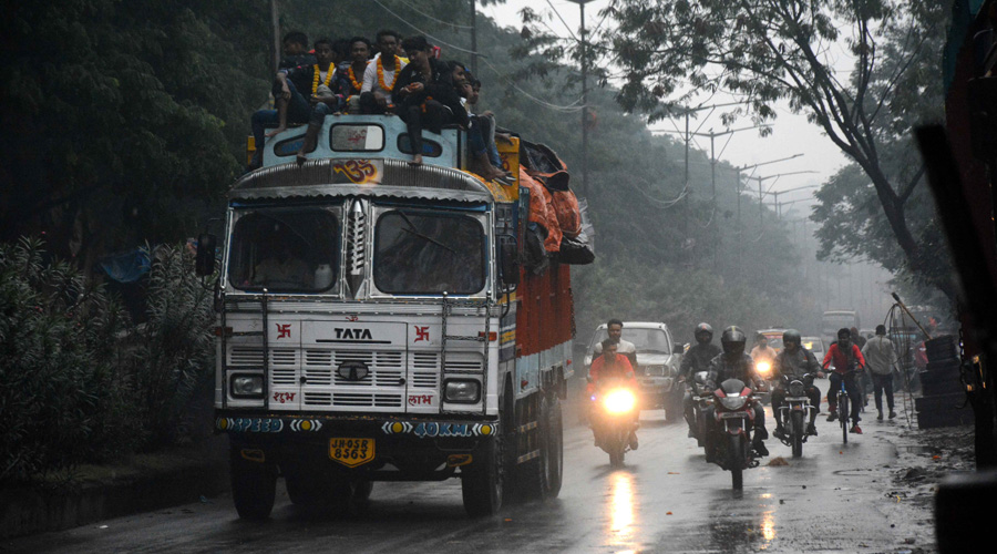 Two-wheelers have headlights on after a bout of rain in Jamshedpur on a cloudy Saturday.