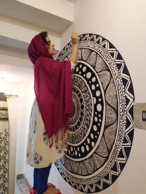 Shafiya Shafi paints a mural in a Srinagar playschool