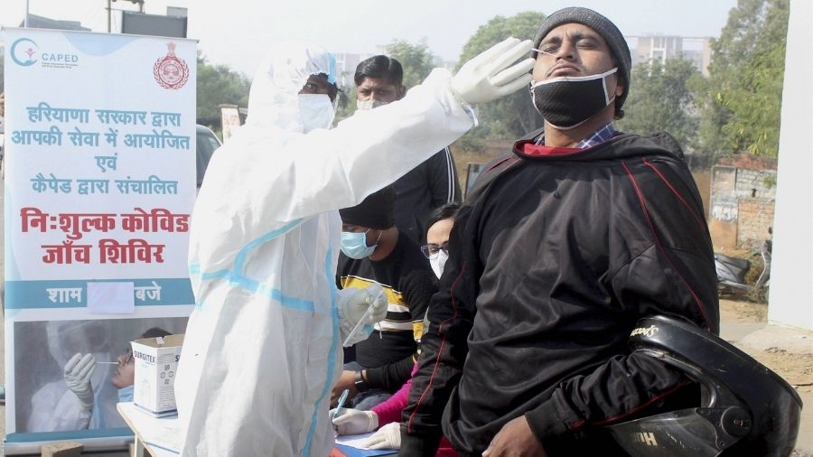 A health worker conducts Covid-19 test in Gurgaon.