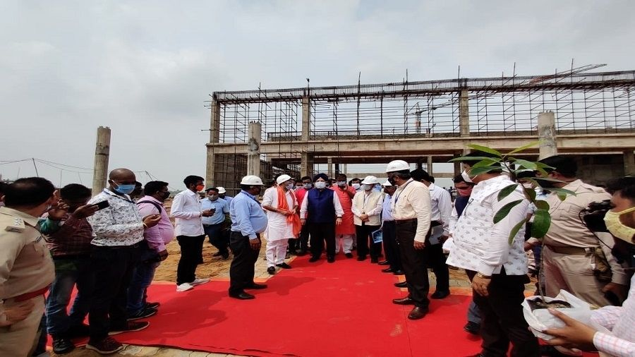 Union civil aviation minister Hardeep Singh Puri (in blue turban), with local leaders and officials, during an inspection at the Deoghar airport site in September.