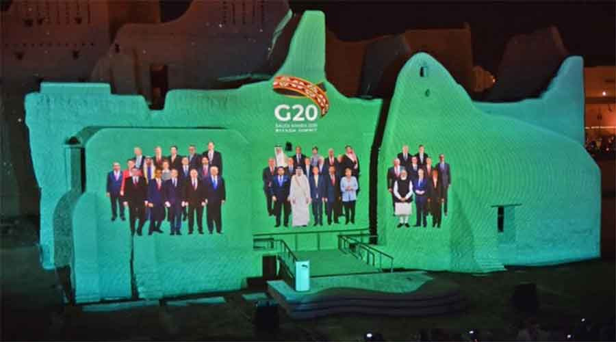 Photos of the heads of the G20 countries being projected on a screen at Salwa Palace at At-Turaif  in Saudi Arabia.