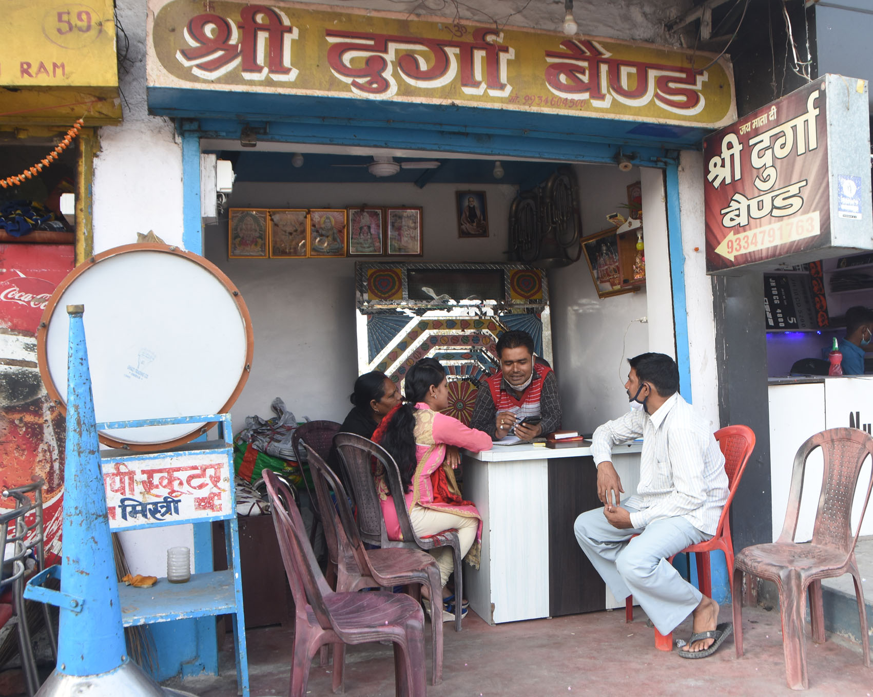 A family booking light and band party at a Light and Band shop in Dhanbad on Monday.