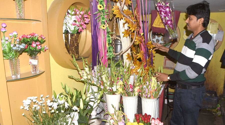 A flower merchant arranging the flowers for decoration in marriage at his shop in court road in Dhanbad on Tuesday.
