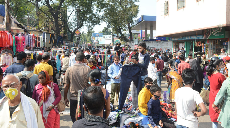 Shoppers and vendors pay little heed to social distancing norms at Sakchi weekly market in Jamshedpur on Tuesday.