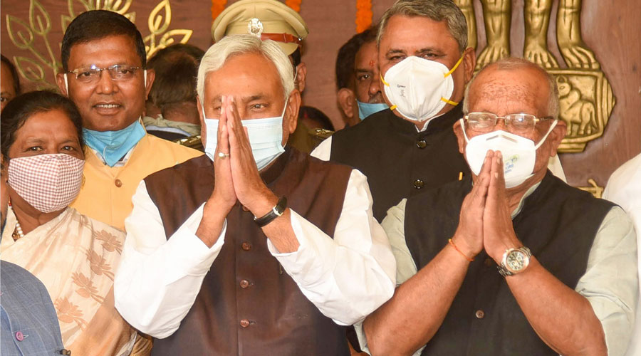 Bihar Chief Minister Nitish Kumar (C) with Deputy Chief Ministers Tarkishore Prasad (R) and Renu Devi (L) arrives at the Assembly for the inaugural session of the 17th Bihar Vidhan Sabha, in Patna on Monday, November 23, 2020.