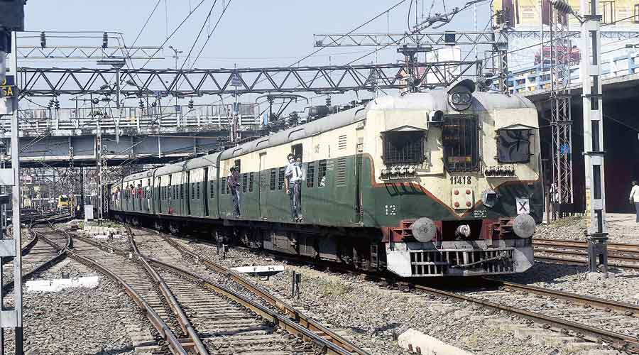 File picture of a suburban train arriving at Howrah station