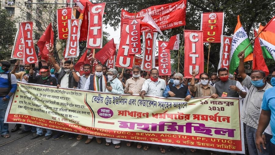Workers of the AITUC and CITU march on a road in Calcutta on Thursday.