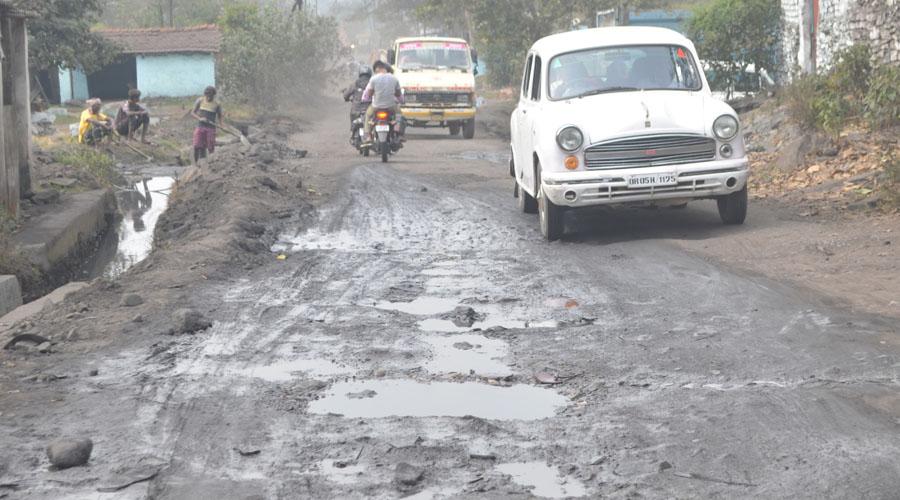 Potholes on Jharia-Baliapur road at Ghanudih, Jharia on Thursday.
