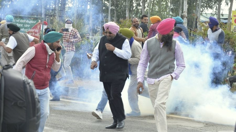 Haryana Police use tear-gas on protesting farmers in Ambala district on Thursday.