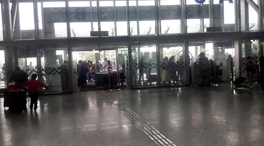 The arrival lounge of the Calcutta airport lit by sunlight during the power cut on Friday