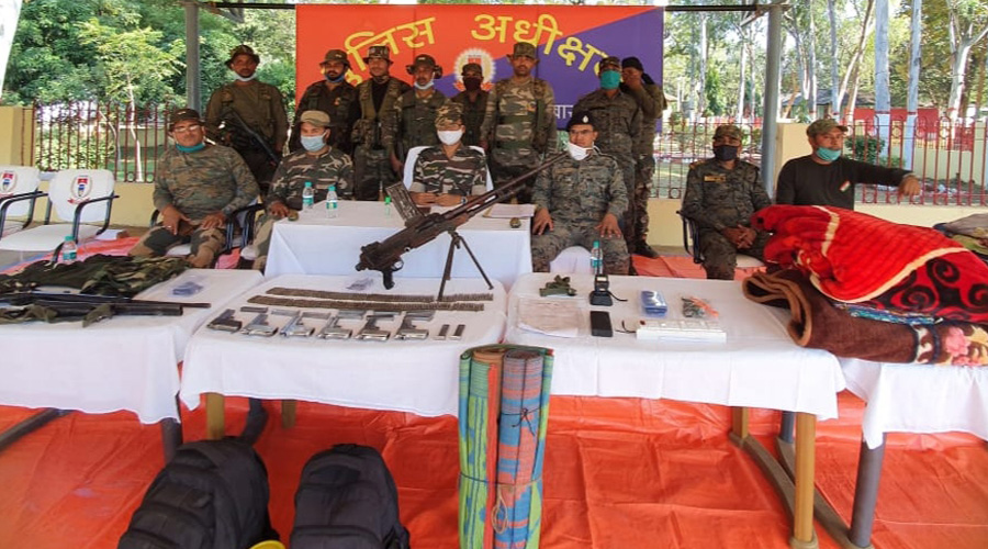 Security forces display the arms and ammunition recovered during the search operation at Chaibasa on Saturday.