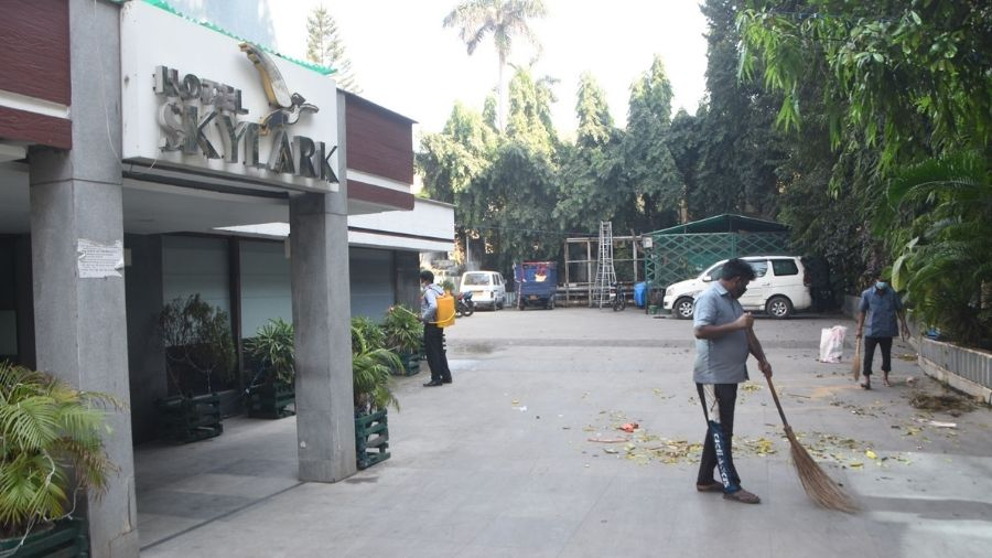 Workers clean the premises of Hotel Skylark at Bank More in Dhanbad on Sunday.