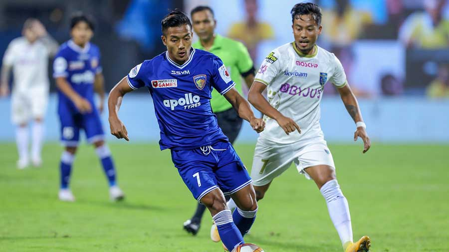 Irom Seityasen of Kerala Blasters FC and Lallianzuala Chhangte of Chennaiyin FC in action during their Indian Super League match at GMC Stadium in North Goa on Sunday.
