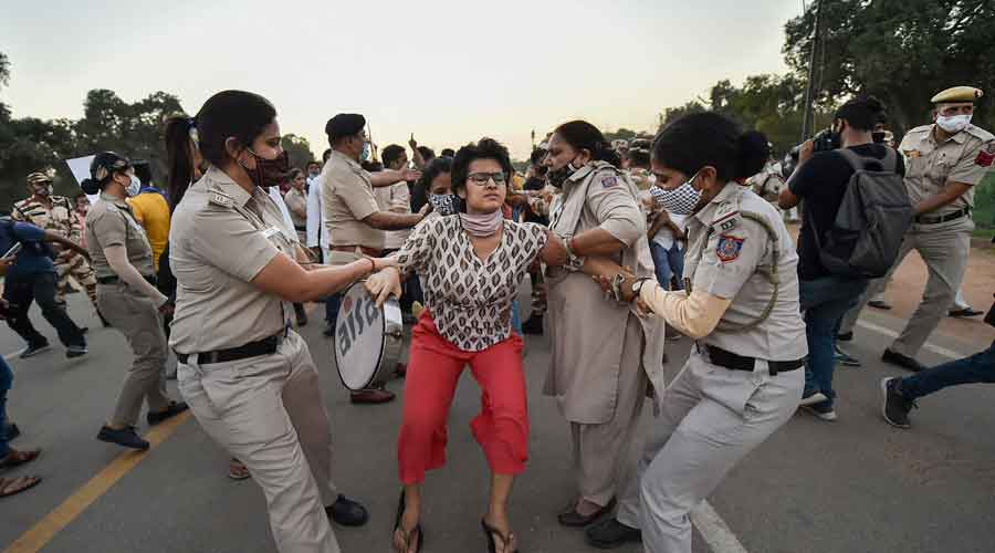 Police detain a protester near India Gate in New Delhi on Wednesday