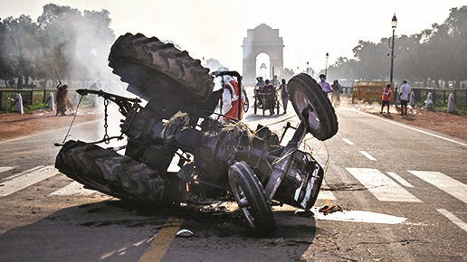 Charred remains of a tractor that was set on fire near India Gate during a protest against the new farm laws, in New Delhi, Monday, Sept 28, 2020.