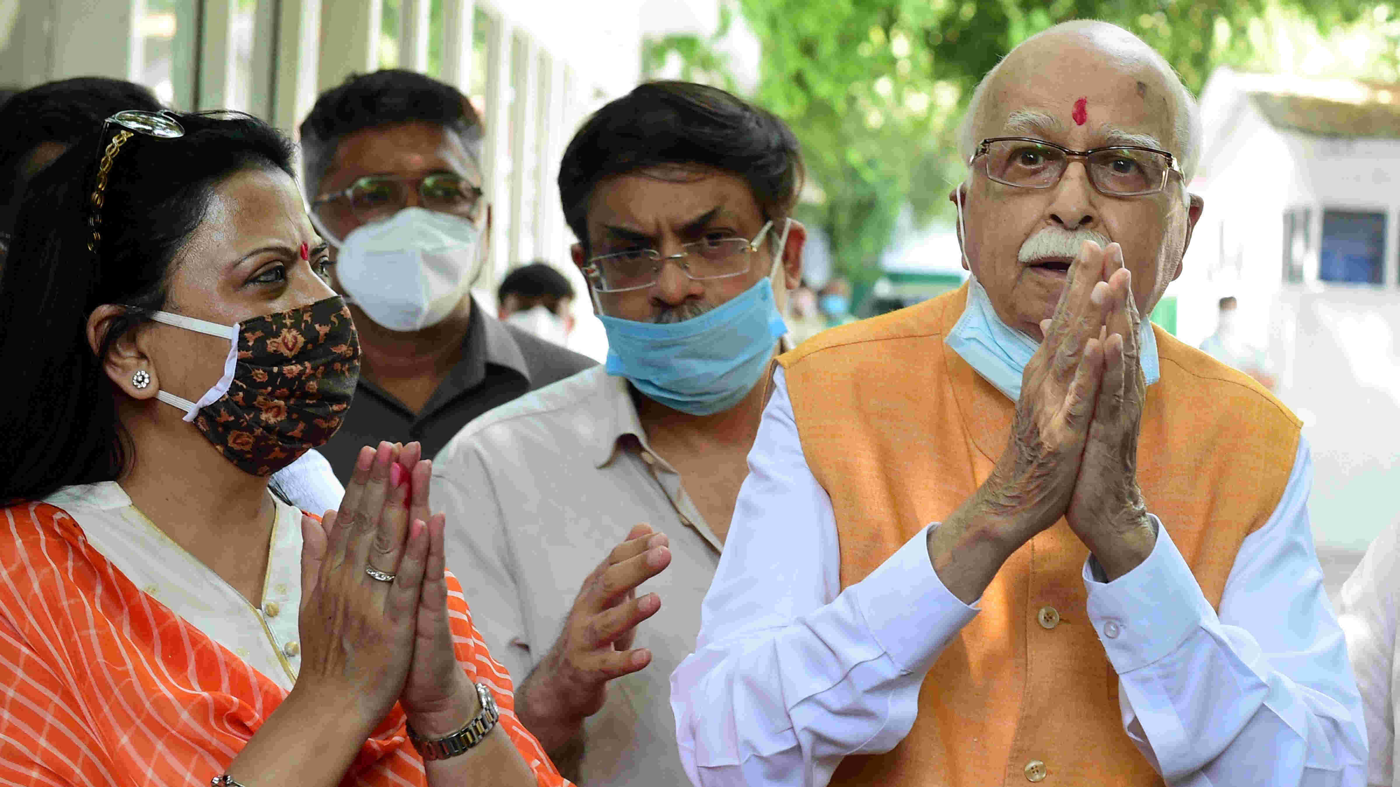Senior BJP leader LK Advani, one the accused in Babri mosque demolition case, along with his daughter Pratibha Advani (L) and son Jayant Advani (C) after the verdict by the special CBI court, outside his residence in New Delhi, Wednesday, Sept. 30, 2020.