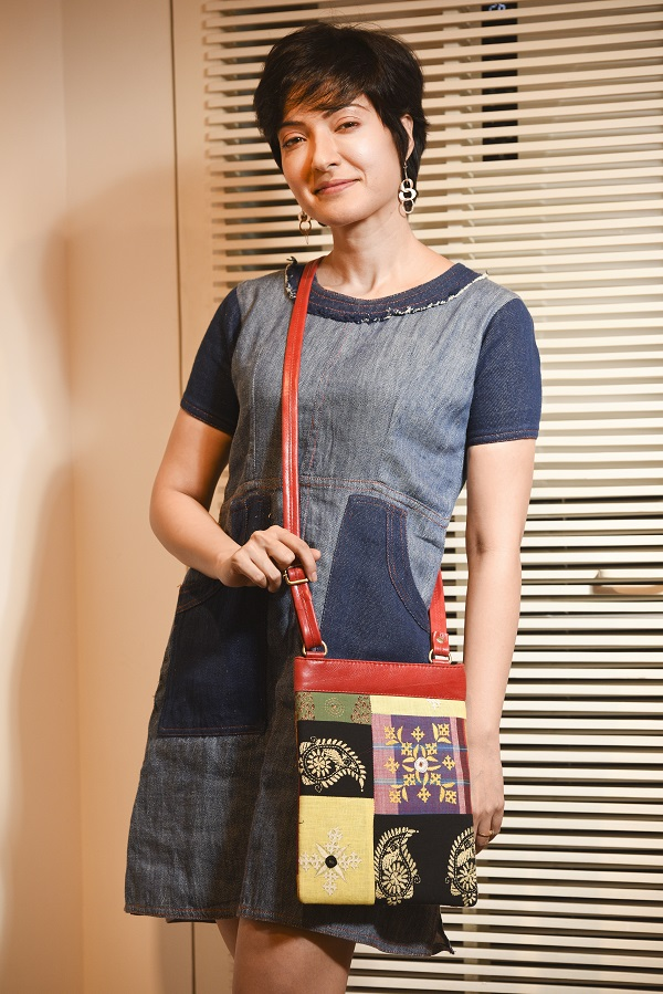 "Arpita teamed a linen anti-fit enzyme-washed denim shift dress from Abhishek Dutta's Parole label with a patchwork, embroidered leather sling bag from CIMA. Silver earrings from the jewellery collection at Art in Life give it a festive touch. (Dress: Rs 4,000, Bag: Rs 1,375, Earrings: Rs 1,275).  ""This Puja is going to be different with a lot of people choosing to stay in or hang out with their friends. This dress is all about comfort and is perfect for a chilled-out day. If you are going out, you can team it with some nice shoes or statement earrings, or just a sling bag to add a pop of colour,"" said Dutta."